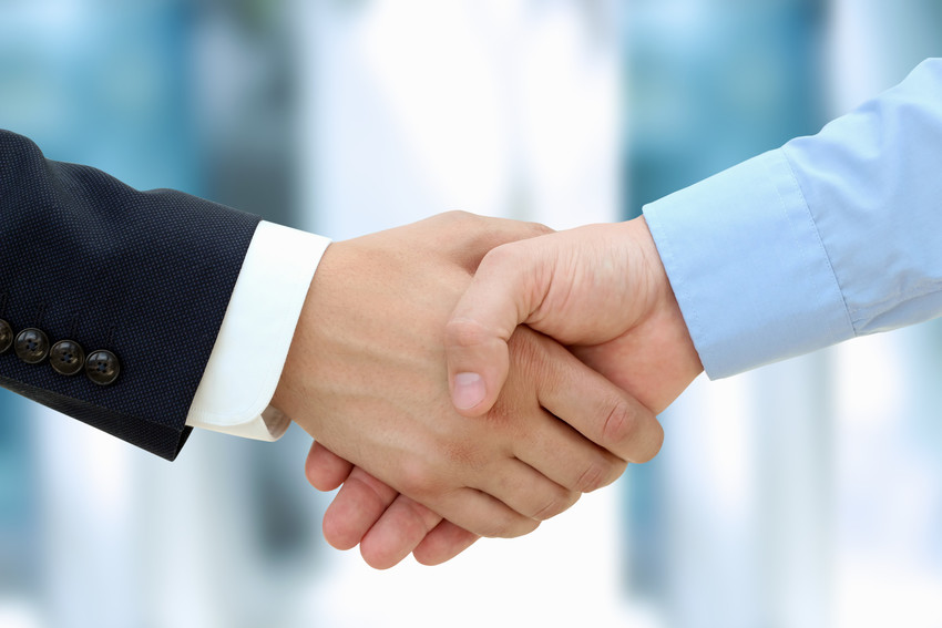 Close-up image of a firm handshake  between buyer and seller