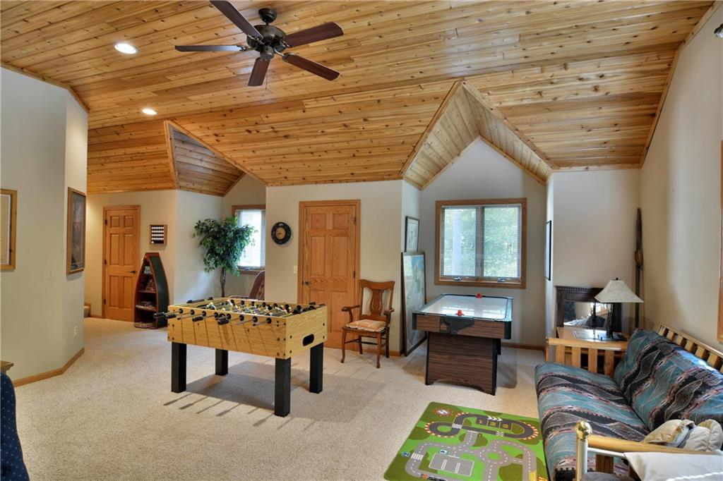 large bonus and game room with gabled windows