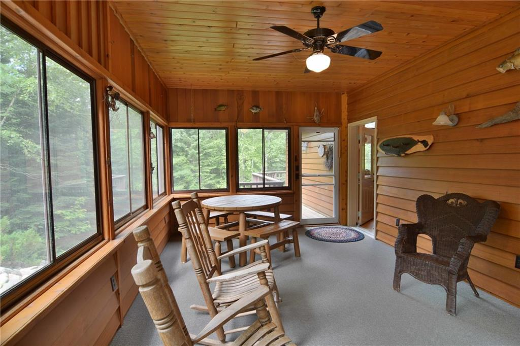 screened porch and deck of 5172 w hwy 77 in clam lake