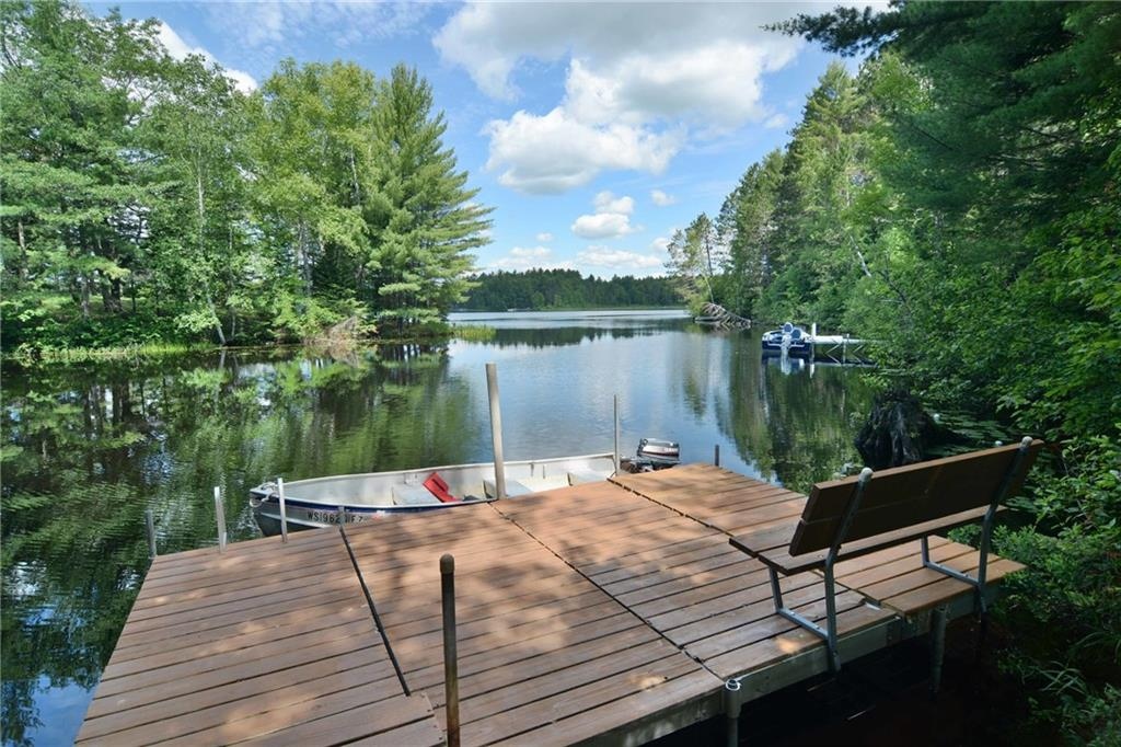 dock with boat at 5172 w hwy 77 in clam lake