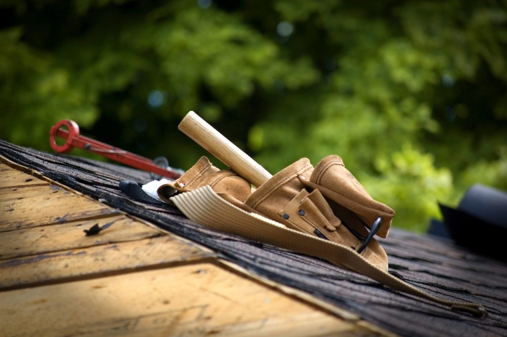 inspecting roof to prepare your home for winter