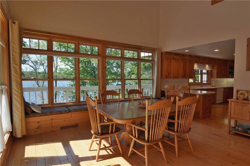 breakfast nook and kitchen in cable featured home for sale