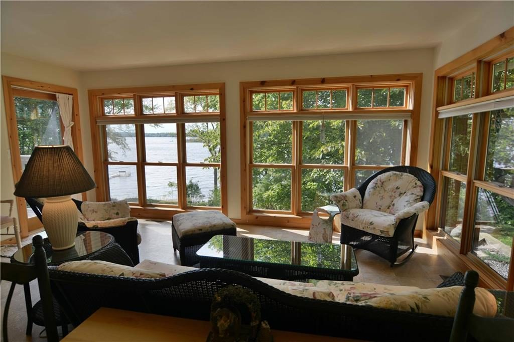 sunroom in cable lakefront home for sale