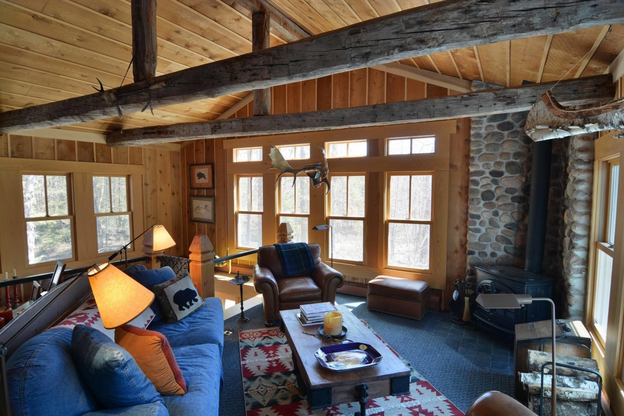 cozy family room in a cable waterfront home for sale