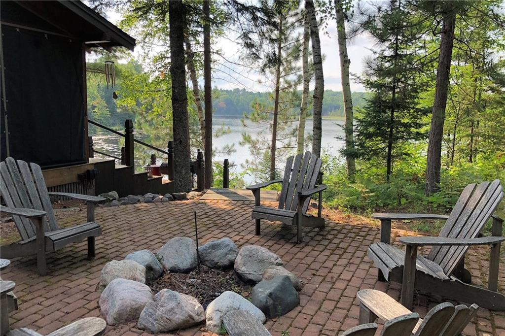 patio with fire pit and lake views at 27425 county highway m in cable wi