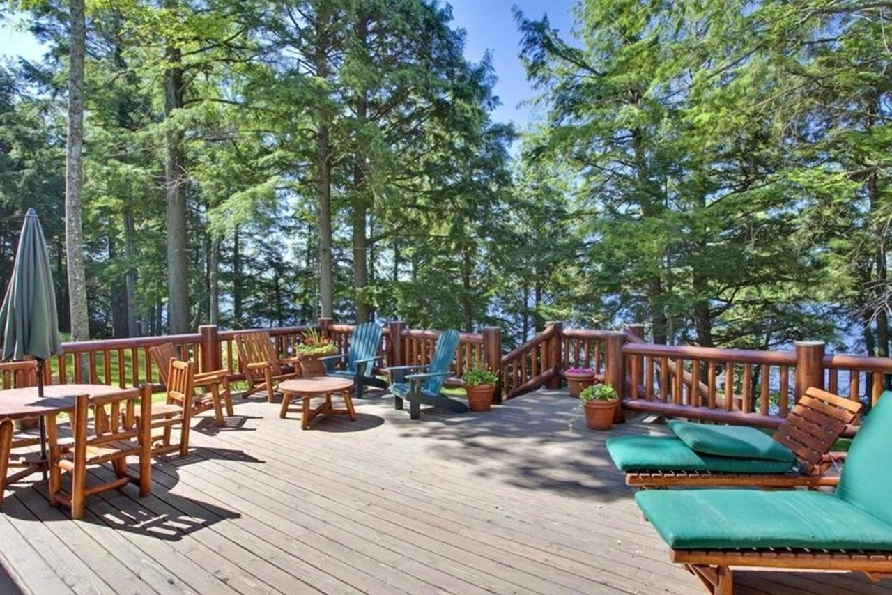 gorgeous back deck with pine and lake views